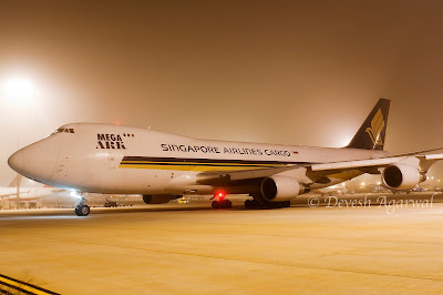 Singapore Airlines Cargo Boeing 747-400F freighter 9V-SFQ night fog at Bengaluru International Airport Bangalore India