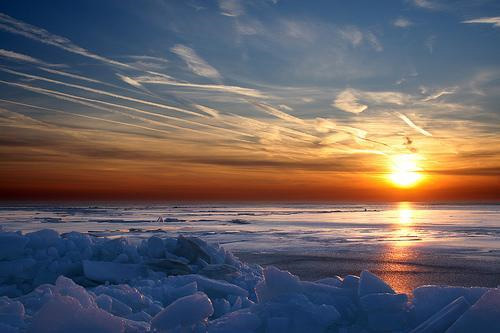 """""""ludington sunset in winter"""" captured by Paul Robertson"""
