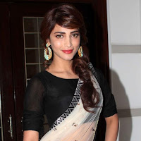 Majestic elegant Shruti haasan light transparent saree stills