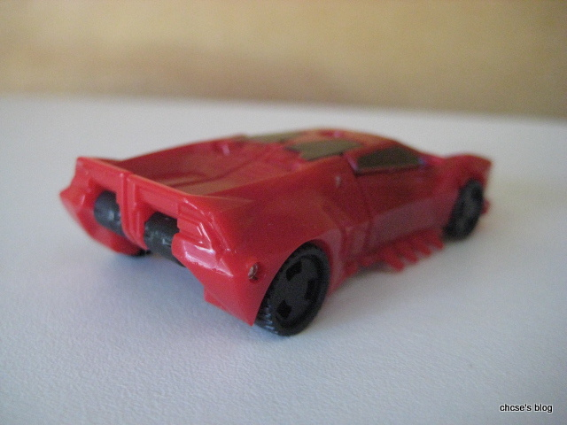 True To His Original Self, Sideswipe Transforms Into A Red Sports Car, With  An Autobot Insignia On The Left Which Which You Can Scan Using The RiD App  To ...