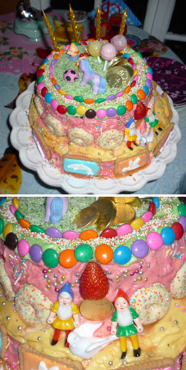 Fun colourful birthday cake with gnomes, doves, lollipops, zoo biscuits, gold coins and a pony: Ellomennopee