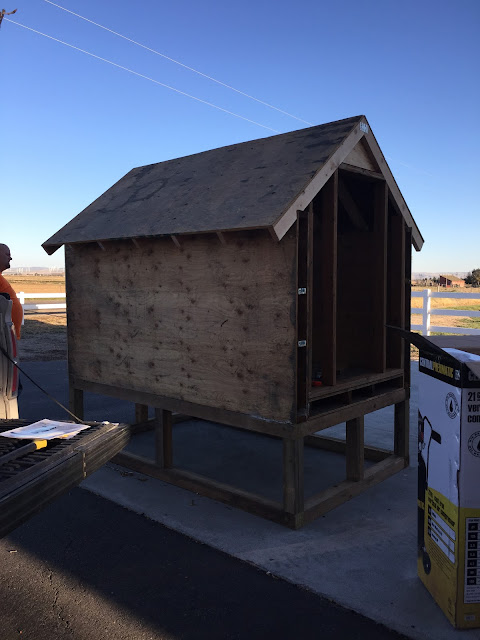 Framing chicken coop with pallets and adding roof
