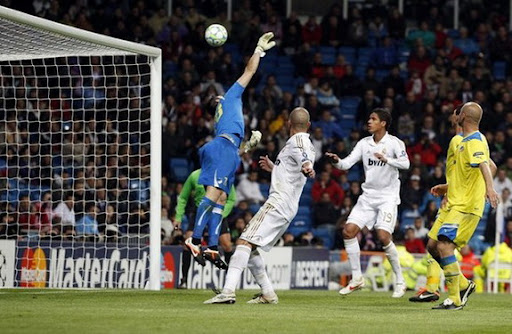 APOEL goalkeeper Urko Pardo fails to stop a goal from Real Madrid player Cristiano Ronaldo