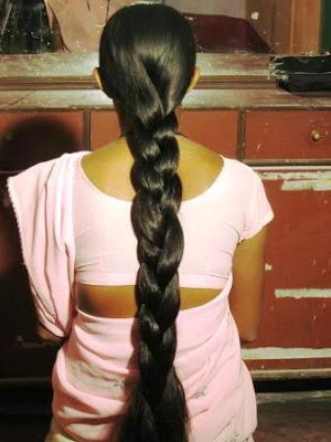 Mumbai long hair lady with thick braid.