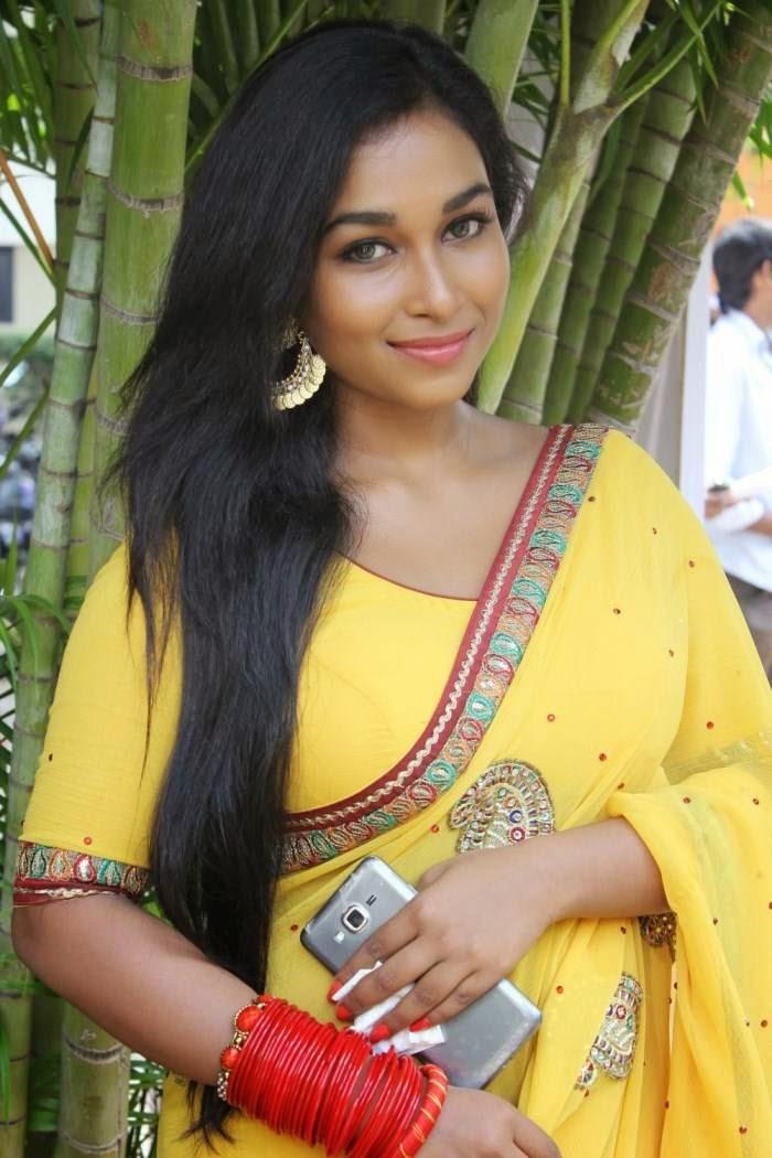 Actress Swathi Latest Cute Hot Transparent Exclusive Yellow Saree Navel Show Spicy Photos Gallery At Savarikkadu Movie Audio Launch