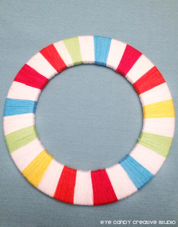 multi colored yarn wreath, wrapped yarn wreath, finished yarn wreath