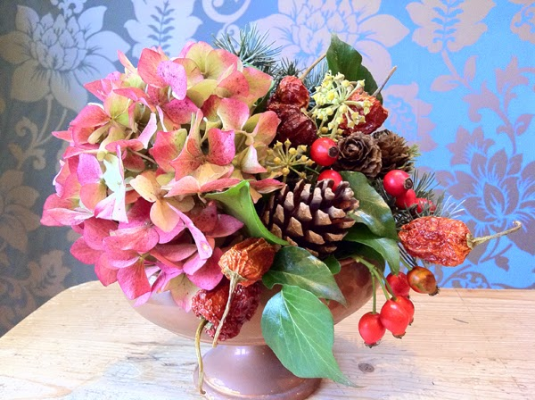 Rustic natural Christmas decoration for table by Sheffield Florist Campbell's Flowers.
