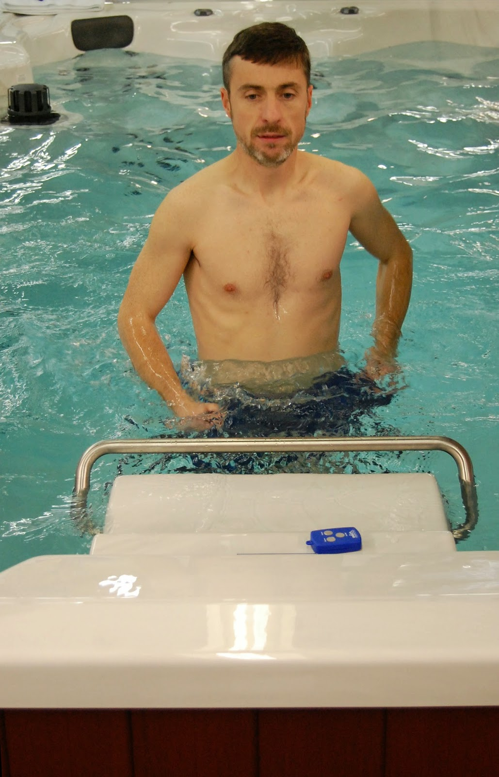 Mark Langan running on the underwater treadmill of an Endless Pool Swim Spa.