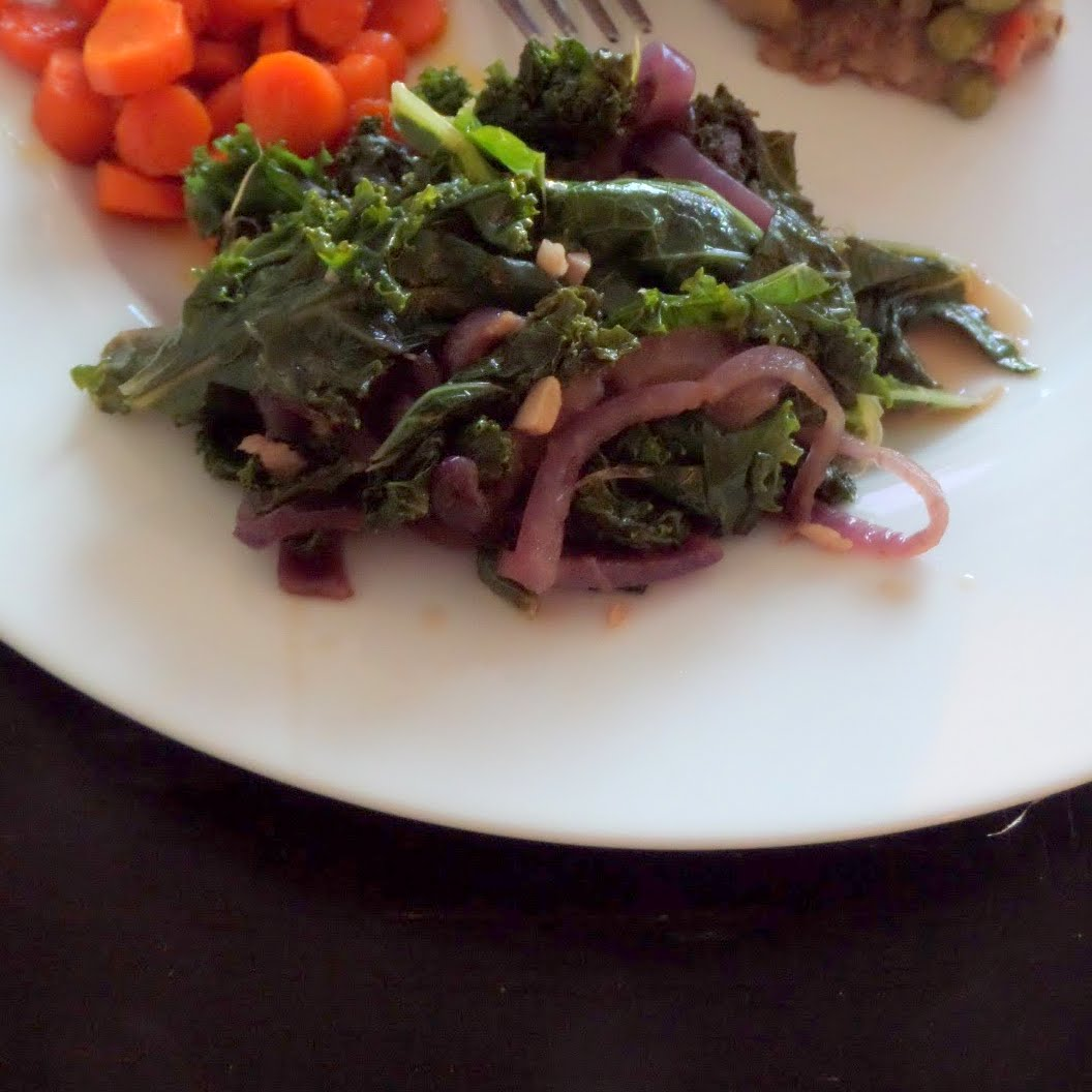 Kale: Warm kale sauteed until tender and flavored with onions, garlic ...