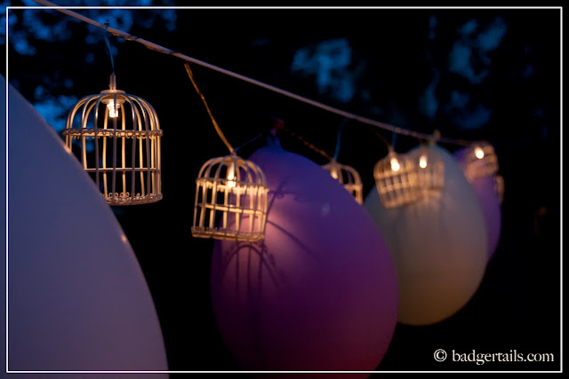birdcage lights and balloon garland summer garden decorating dining
