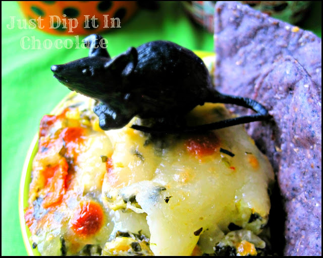 Rat's Nest Halloween Spinach and Artichoke Dip! Heat up the Souls of the Zombies at your party with this Hot Spinach and Artichoke Dip! A great Halloween party needs a great dip, this is it!