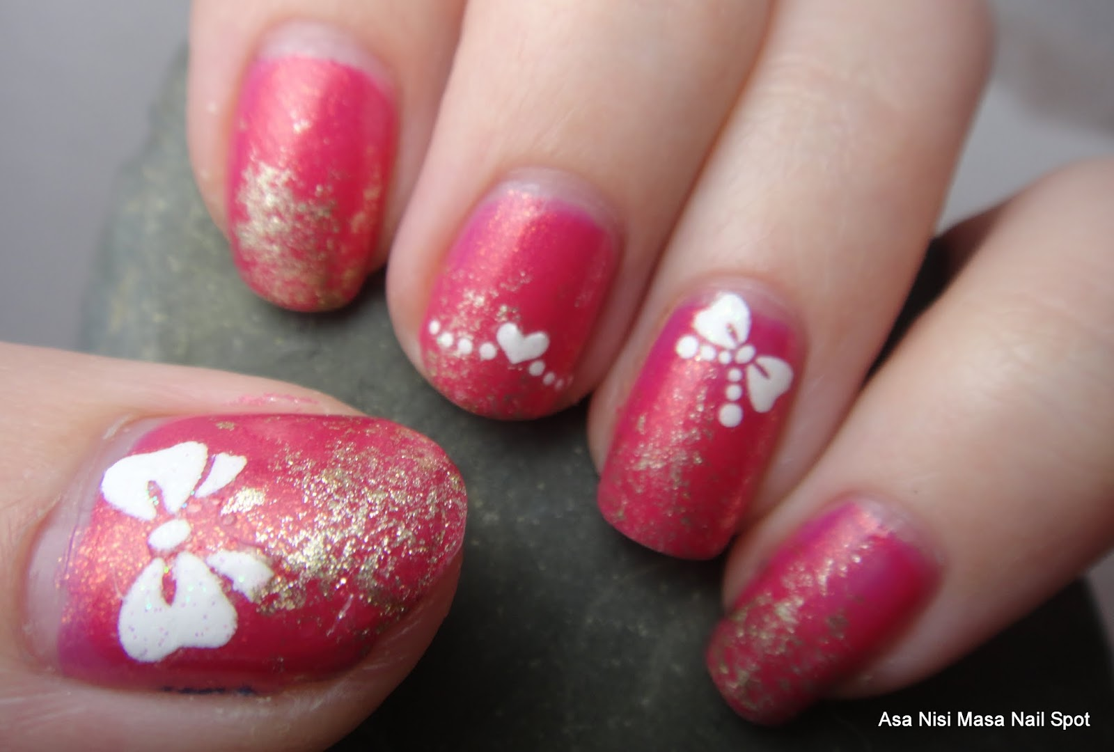 asa nisi masa nail spot pink and glittery with bows the