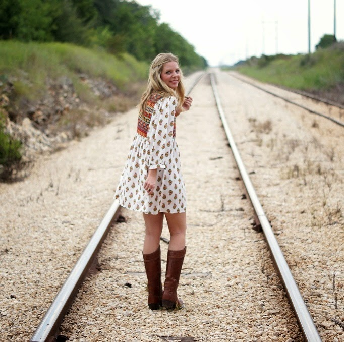 printed shift dress with cowgirl boots