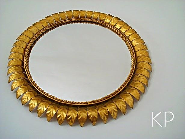 Espejos sol vintage. Años 50, dorados, con forma redonda.