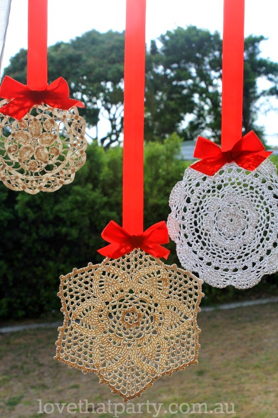 vintage doily DIY Christmas decorations hanging from window