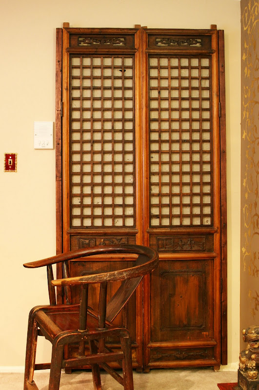 In the entry these antique Chinese doors are a great fit for my closet  title=