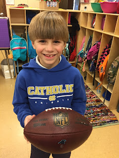 Holy Spirit Campus First Grader Shares A Tall Tale and Game Ball for Show & Tell 1