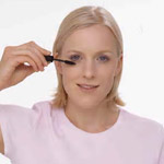 a woman applying eye make-up