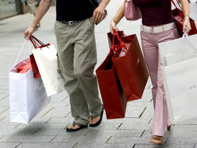 Couple holding several packages after shopping together.