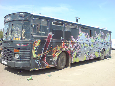 Unidentified traveller bus, covered in graffiti at a French teknival near Crucey in 2008