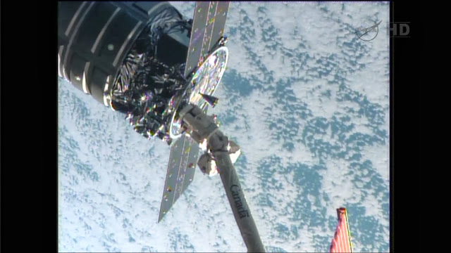 The Cygnus commercial resupply craft is captured by the Canadarm2 with Luca Parmitano at the controls. Image Credit: NASA TV