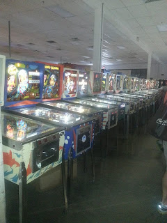 Interior picture of a row of pinball machines at the Pinball Hall of Fame.
