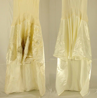 Vintage Silk Satin Wedding Dress Underskirt with Mold Damage due to storing the gown in a basement with plastic around it. This vintage garment restoration was performed at Janet Davis Cleaners in Berkley, MI.