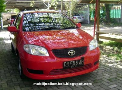 Toyota Limo eks taksi Blue bird group Lombok Taksi warna merah