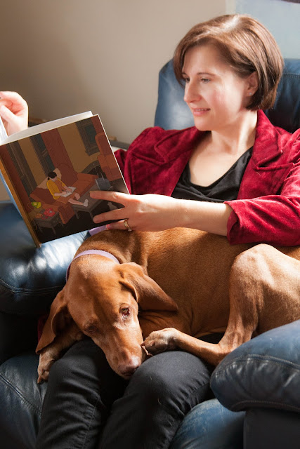 woman reading with dog on her lap