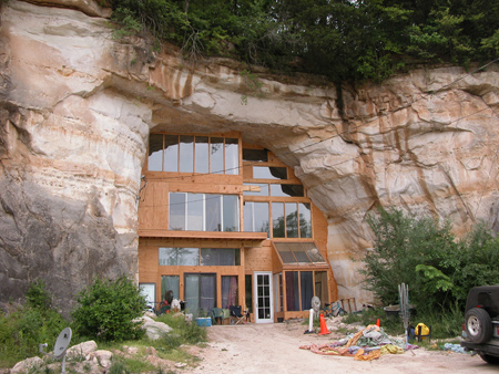 Solid planet caveland a perfect home built in a cave House built into mountain