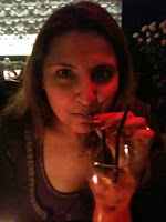 self photo drinking a cocktail