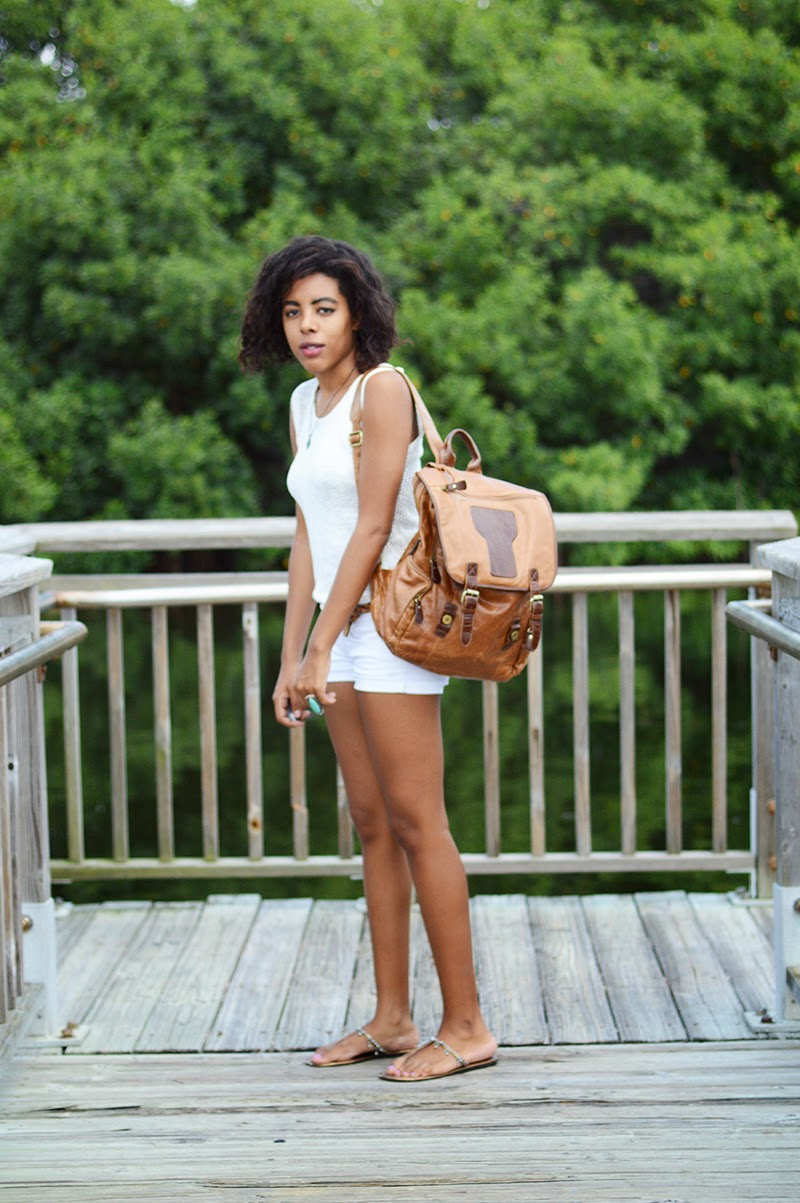 Miami Fashion Blogger Anais Alexandre of Down to Stars in a white top and shorts from Target and old navy sandals with a leather backpack for school