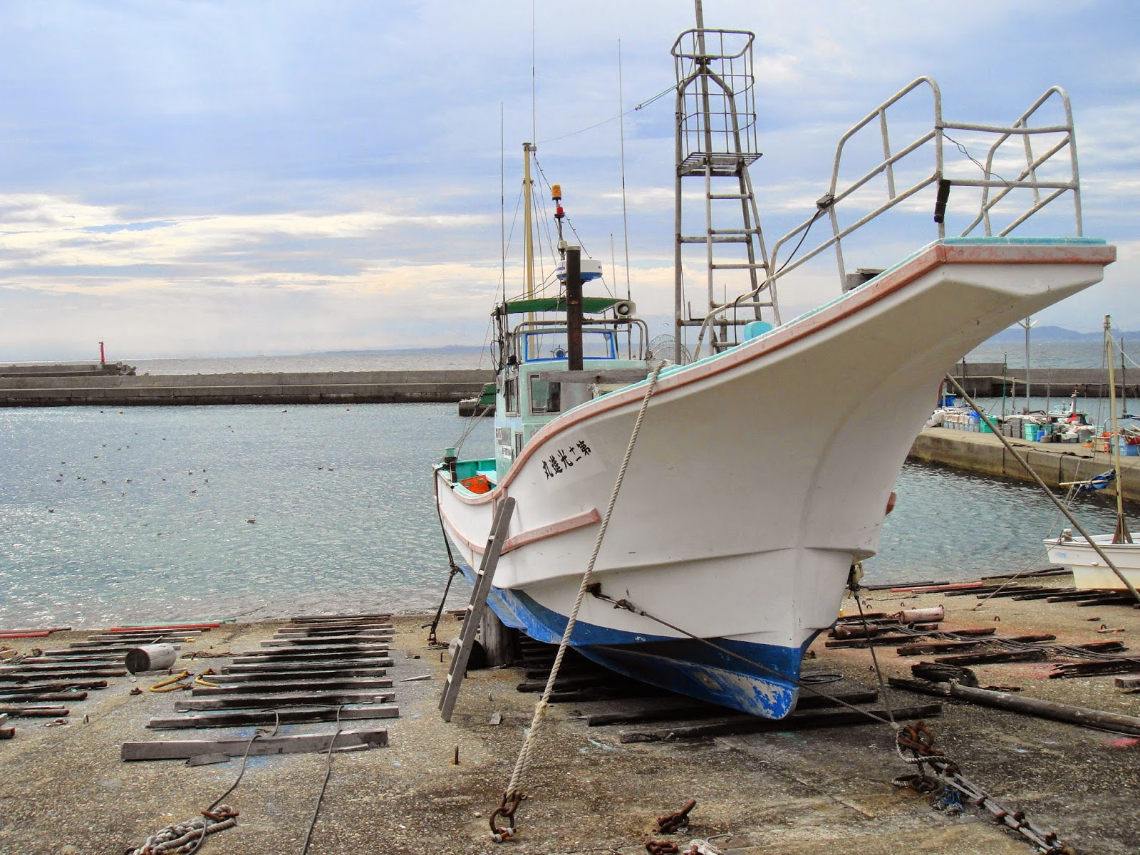 A small fishing boat in a fishing village
