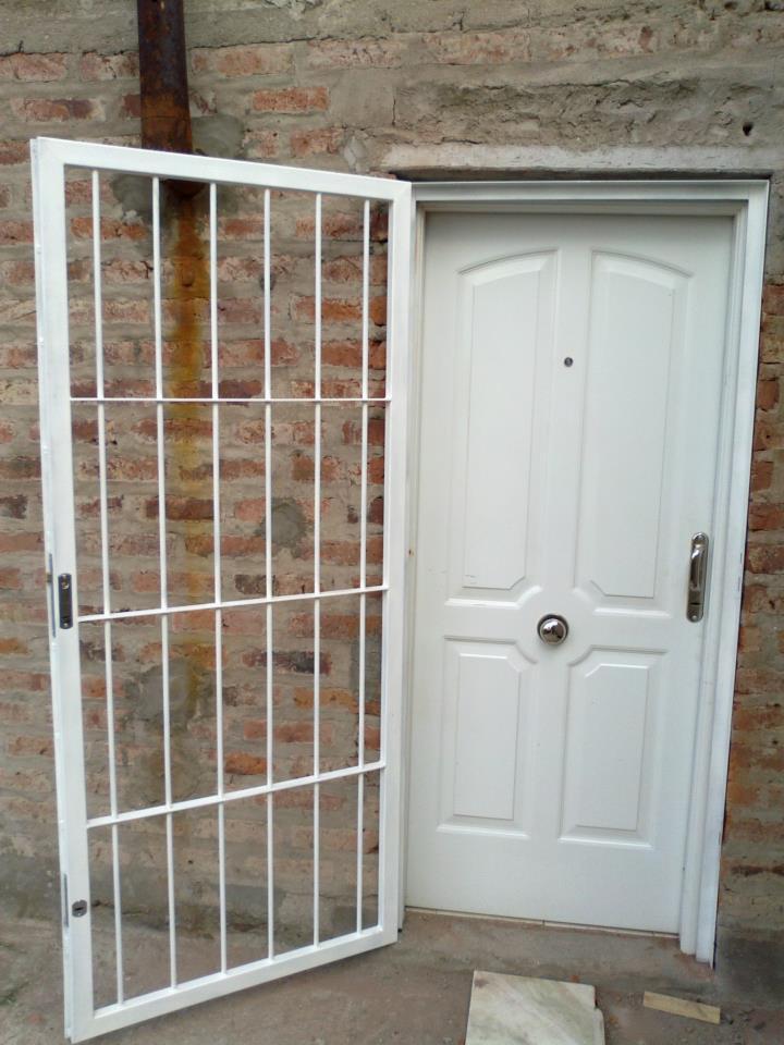 Disenos de puertas de rejas pictures to pin on pinterest for Puertas de diseno