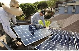 Solar panel installation. Google has boosted its investment in solar by putting $75 million into a fund that solar installers can draw on to finance solar panels on homes. (Credit: David McNew / Getty Images) Click to enlarge.