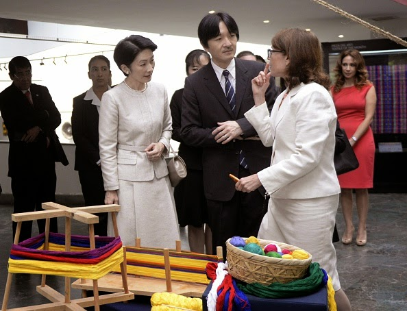 Japan's Prince Akishino (C) and his wife Princess Kiko (L) listen to expert Barbara de Arathoon during a visit to the Popol Vuh Museum in Guatemala City