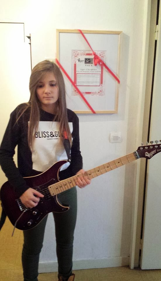 Tina S the girl who plays guitar with great talent