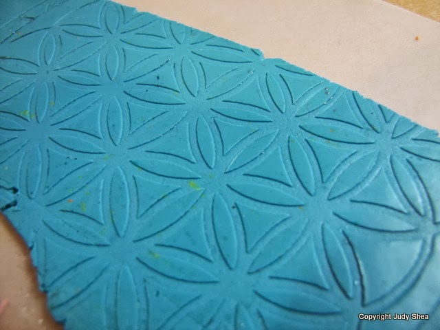 Polymer clay tutorial using stencils to make colorful bookmarks.