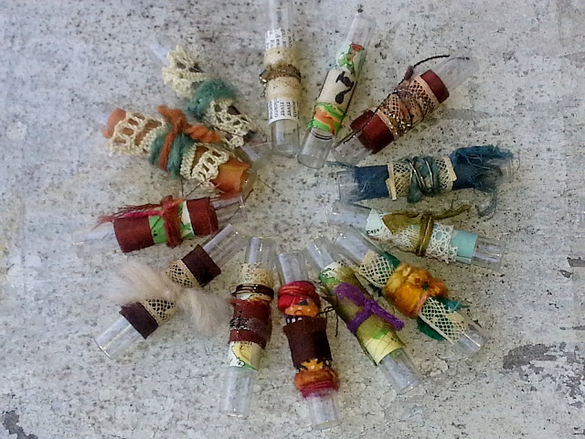 fiber arts collage on recycled glass vials