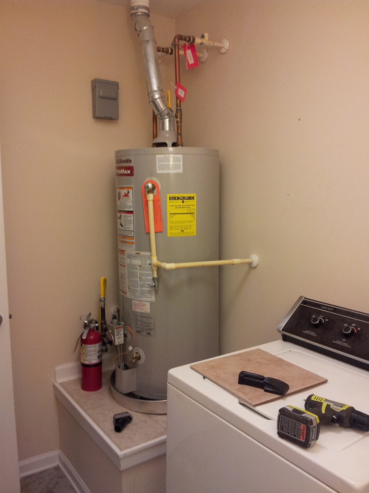 Duo ventures laundry room makeover so you get the idea not cute or functional our water heater is also conveniently located in our laundry room also not so cute solutioingenieria Images