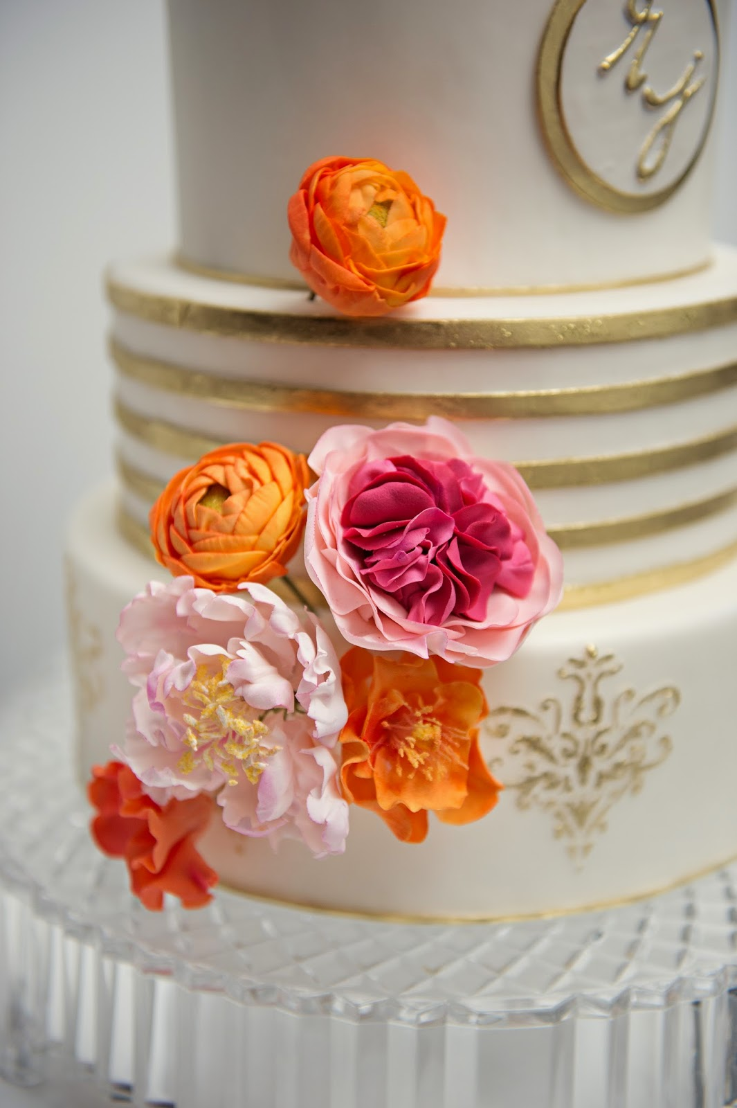 ct white gold pink & orange wedding cake with sugar flowers