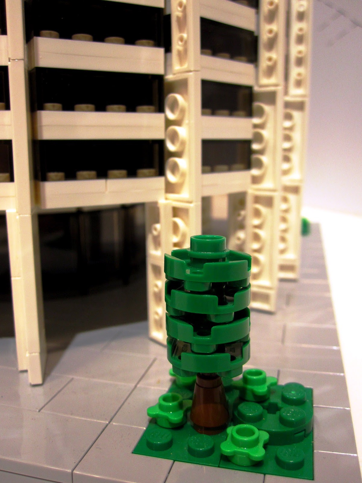 Close-up of a Lego tree at the base of a Lego model of Harry Seidler's Austraia Square.