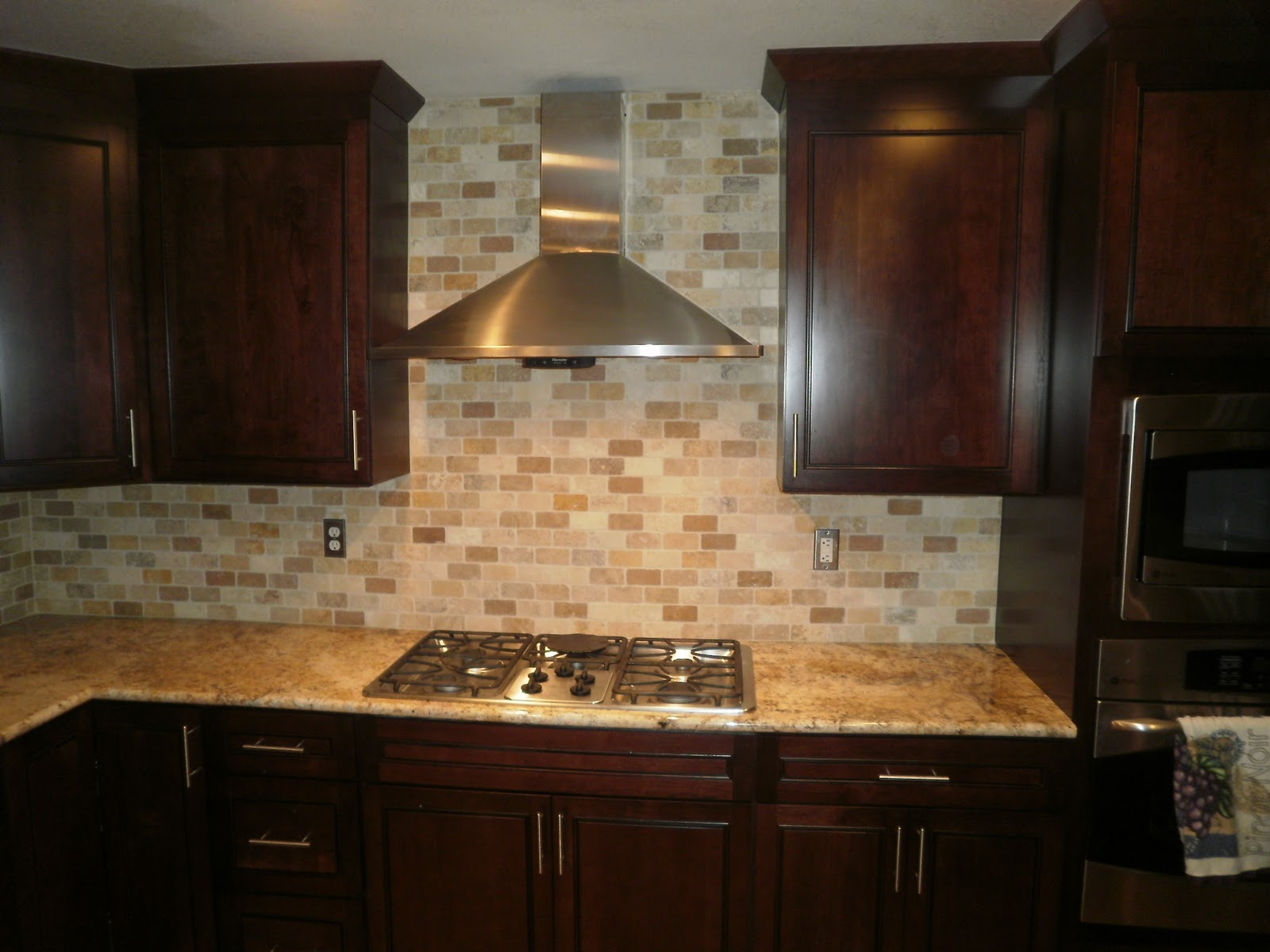 of front range backsplash 2x4 tumbled marble backsplash completed