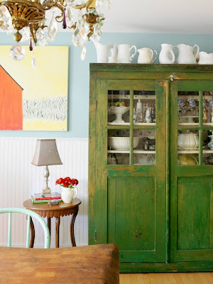 mylittlehousedesign.com collection of white pitchers on top of china cabinet