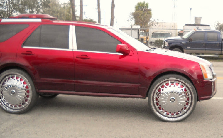 "Cadillac SRX on 28"" DUB Kingster Floaters"