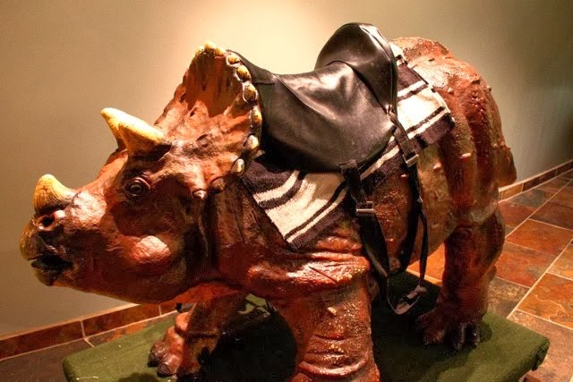 dinosaur wearing saddle from creation museum in kentucky