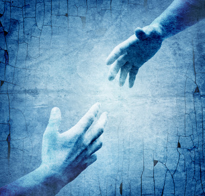 two hands reaching for each other with blue background