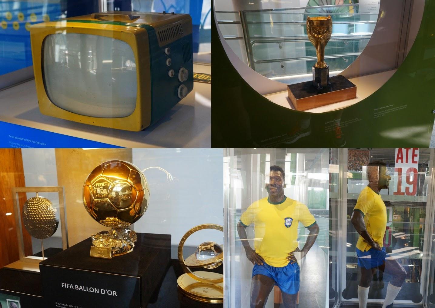 exposição do Museu Pelé - tv verde e amarela de 58, réplica do troféu Jules Rimet, troféu Bola de Ouro da FIFA e boneco réplica de Pelé.