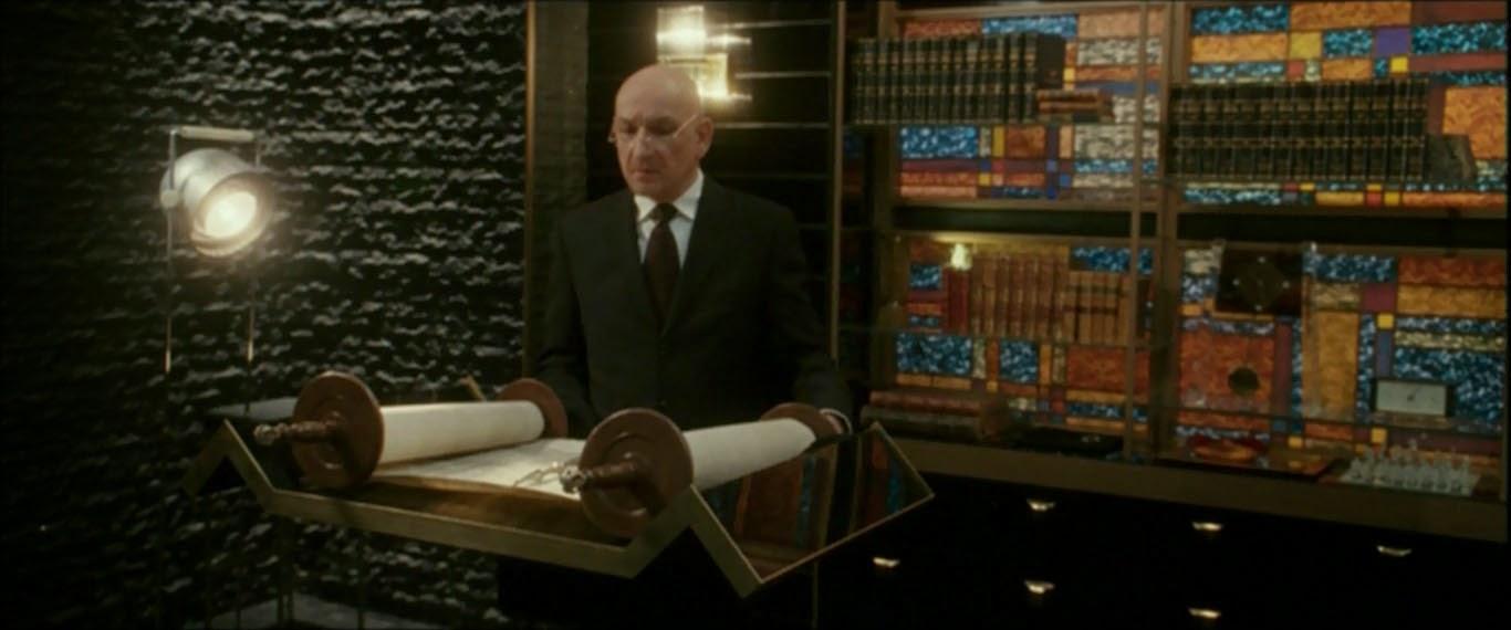 man reading religious scroll