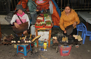 Grilling food for sale at night in Sapa town